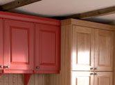 Kitchen in light oak and red